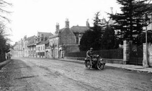 AOS P 1816 A lovely image of a vintage motorbike heading out from Market Deeping some time in the 1930s.