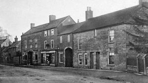 AOS P 1829 High Street Market Deeping pictured around 1954.