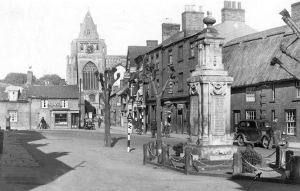 AOS P 2896 East Street, Crowland in the 1950s with the war memorial in the foreground.