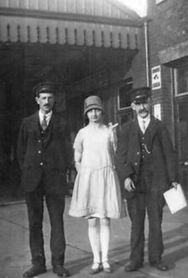 Station Staff with a young lady, Spalding