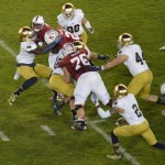 Dan Fox & Jaylon Smith bring down a Stanford ball carrier. (Daniel Hartwig via Flickr)