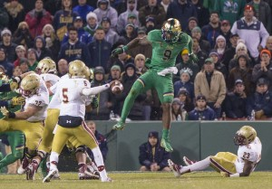 Notre Dame's Jaylon Smith (9) leaps over Boston College's Myles Willis (23) as QB Jeff Smith (5) passes during the second half of the Notre Dame-Boston College NCAA football game on Saturday, Nov. 21, 2015, inside Fenway Park in Boston, Mass. SBT Photo/ROBERT FRANKLIN
