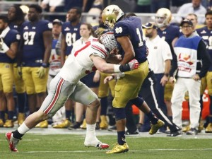 Ohio State defensive lineman Joey Bosa was ejected from the game for targeting Notre Dame quarterback DeShone Kizer. (Photo: Rob Schumacher/azcentral sports)