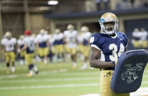 Dexter Williams (34) runs drills with his teammates during Notre Dame spring football practice inside the Loftus Center. (Tribune Photo/BECKY MALEWITZ)