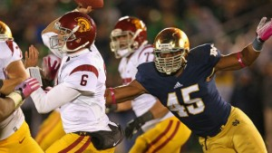 SOUTH BEND, IN - OCTOBER 19: Cody Kessler #6 of the University of Southern California Trojans passes as Romeo Okwara #45 of the Notre Dame Fighting Irish rushes at Notre Dame Stadium on October 19, 2013 in South Bend, Indiana. Notre Dame defeated USC 14-10.  (Photo by Jonathan Daniel/Getty Images)