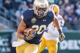 Dec 30, 2014; Nashville, TN, USA; Notre Dame Fighting Irish wide receiver C.J. Prosise (20) carries the ball in the first quarter against the Louisiana State Tigers at LP Field. Notre Dame won 31-28. Mandatory Credit: Matt Cashore-USA TODAY Sports