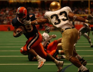 SU's Walter Reyes scores his fifth touchdown of the day against Notre Dame as he runs past Courtney Watson in the fourth quarter on December 6, 2003. Syracuse won 38-12. (Syracuse.com/Post-Standard 2003)
