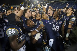 Navy celebrates their 44-28 victory over Pittsburgh in the 2015 Military Bowl at Navy-Marine Corps Stadium in Annapolis, Md. Dec. 28, 2015. (DoD News photo by EJ Hersom)