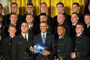 President Barack Obama holds a Navy football helmet & ring while pausing for a photo with the Naval Academy football team after the president awarded the Commander in Chief's Trophy to the team at the White House in Washington, D.C. April 27, 2016. (DoD News photo by EJ Hersom)
