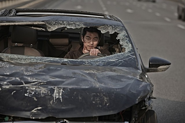 Seriously, never lend this man your car. Dong-chul (Gong Yoo) worries about his insurance premiums.