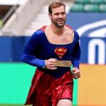 NFL Player Warms Up While Dressed As Supergirl