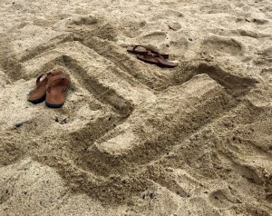 """One Year Anniversary, """"1"""" drawn in the sand next to flip flops"""
