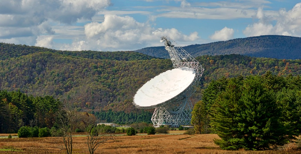 The Robert C. Byrd Green Bank Telescope (GBT) located at the Green Bank Observatory points skyward listening for signals from deep space