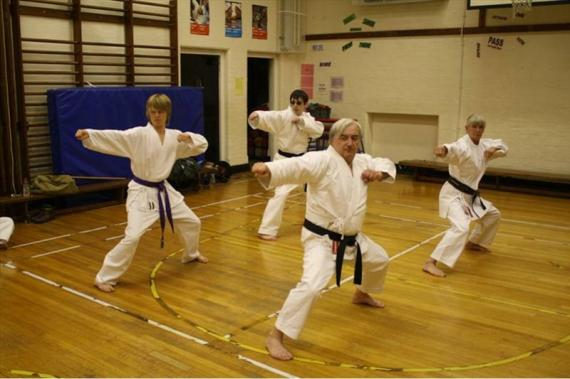 Harry working with the Black belts to improve his Kata
