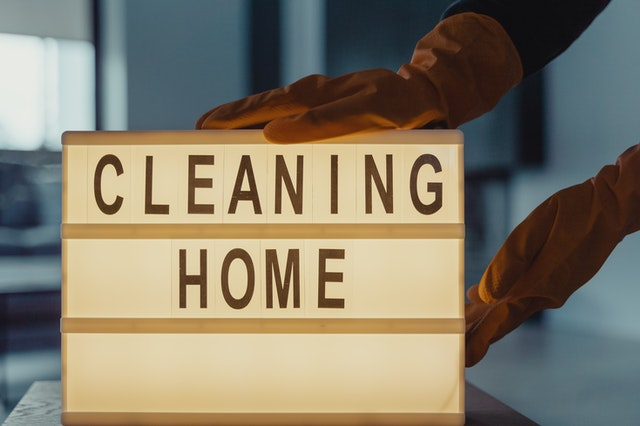 cleaning home sign that symbolizes cleaning and sanitizing during a move