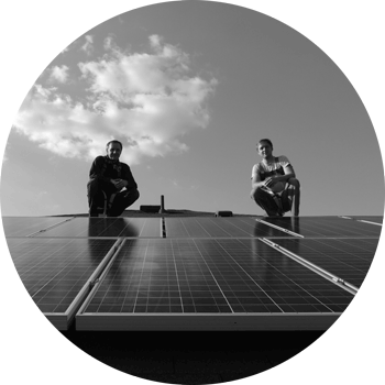 owners Eric and Derrick Hoffman on a roof above solar panels