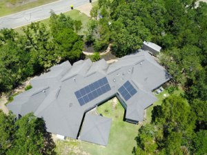 birds eye view of solar panels on a roof in Bastrop Texas