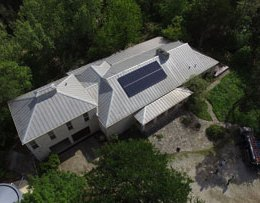 Pansonic panels making a rectangle shape on a Metal roof in the Dripping Springs area
