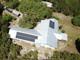 HESOLAR installation of solar panels on a metal roof in Wimberley