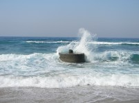 Hibberdene concrete pillar in the waves breaking on the beach