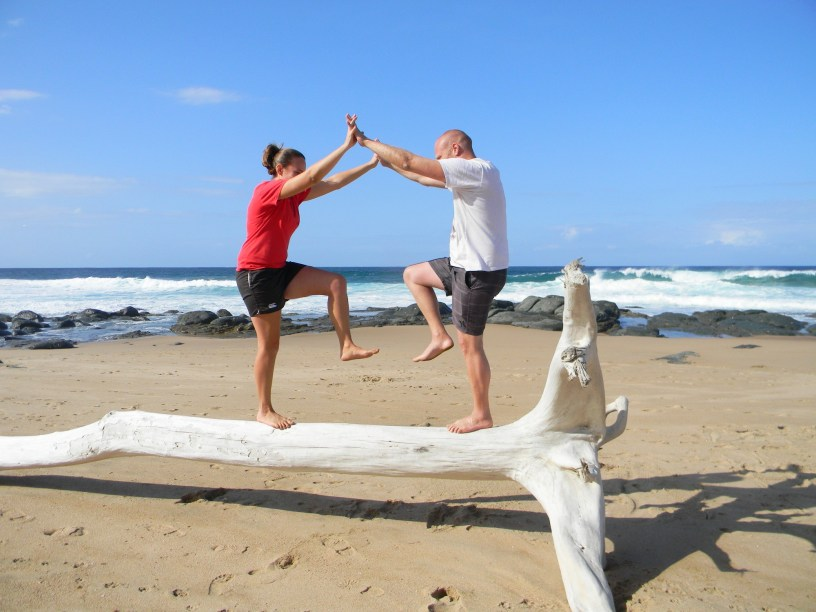 Learning to balance on driftwood at Ifafa Beach