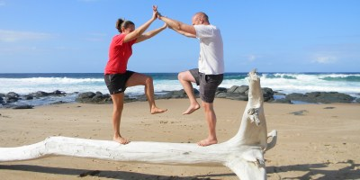 Learning to balance on driftwood at Ifafa Beach