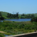 Dam next to the N2 freeway with sugarcane fields on the hills in the background