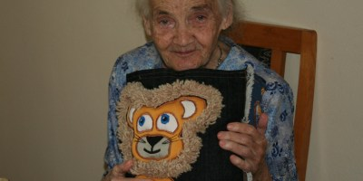 My mother at age 95, hugging a cushion, a gift from my daughter