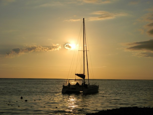 Sailboat passing at sunset Club Med La Pointe aux Canonniers, Mauritius