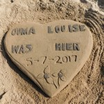 Sand art plague at the request of a visitor on St Michaels on Sea Beach in KwaZulu-Natal