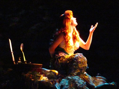 Image of Disney Princess Ariel the Mermaid singing at the Voyage of The Little Mermaid – Hollywood Studios.