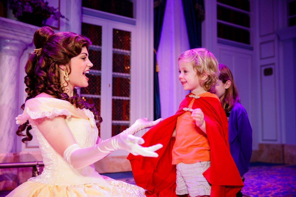 Disney Princess Belle meets a little boy wearing a Prince cape. Walt Disney World attractions lifestyle shoot. April 2013. Photographer: Cynthia Perez