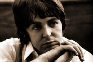 Brown tinted photo of Paul McCartney