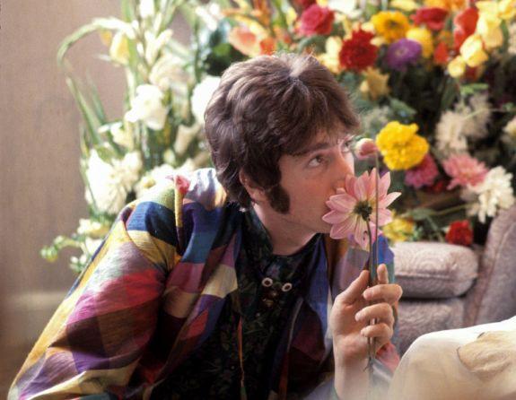 Lennon smelling a daisy