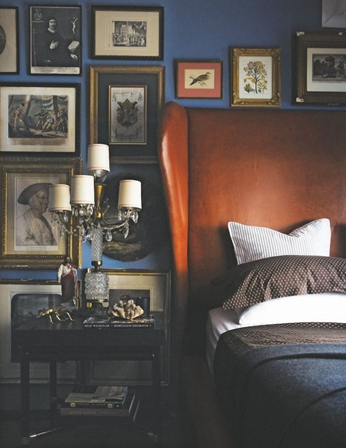 Blue bedroom with gallery wall