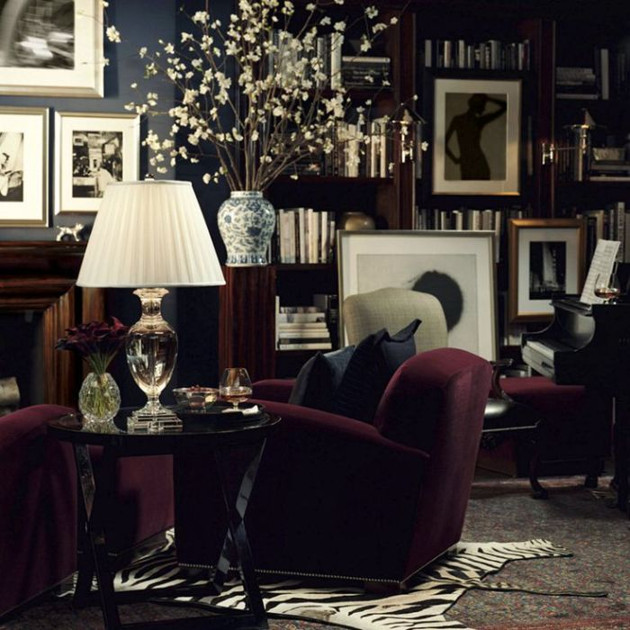 Opulent dark blue room with burgundy armchairs