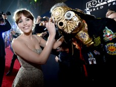 """HOLLYWOOD, CA - DECEMBER 10: Actress Felicity Jones (L) signs Christopher 'Dude Vader' Canole's helmet at The World Premiere of Lucasfilm's highly anticipated, first-ever, standalone Star Wars adventure, """"Rogue One: A Star Wars Story"""" at the Pantages Theatre on December 10, 2016 in Hollywood, California. (Photo by Charley Gallay/Getty Images for Disney) *** Local Caption *** Felicity Jones; Christopher Canole"""