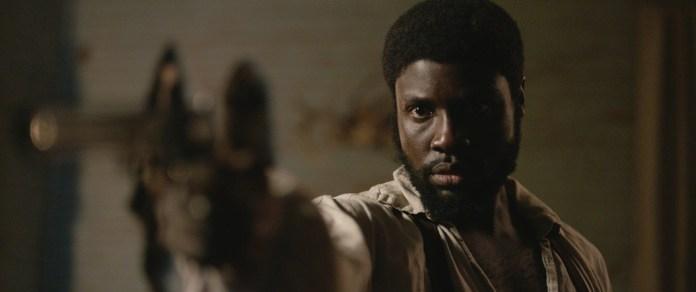 Dayo Okeniyi with gun - Emperor