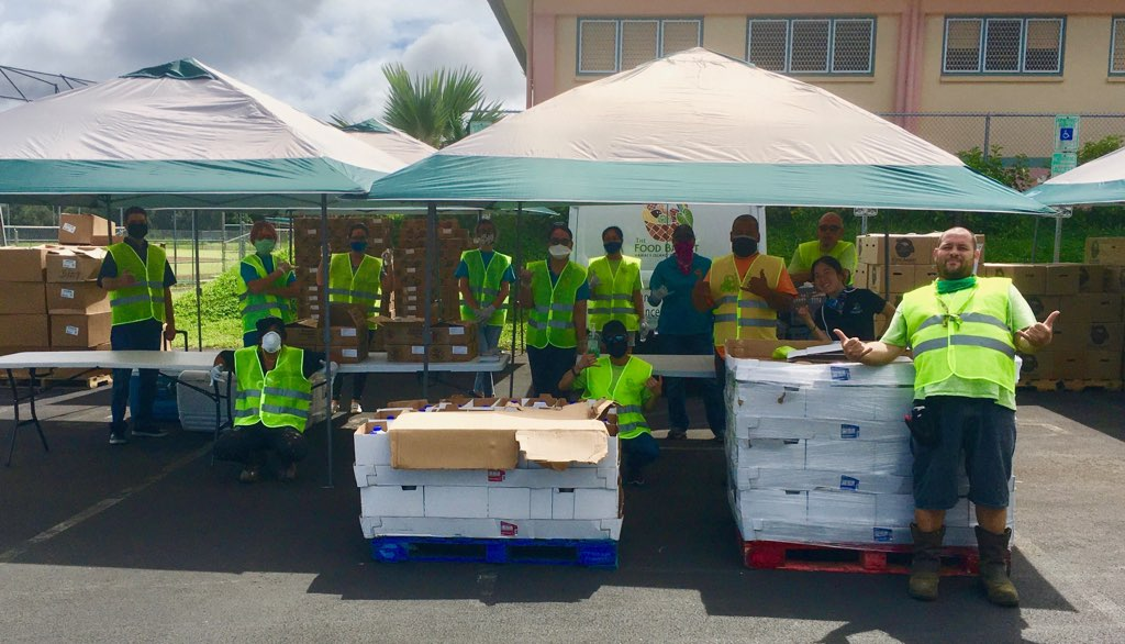 Volunteers at the Keaau Food Drive donating milk, eggs, and other food items