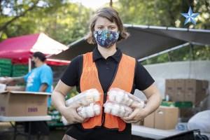 Woman with eggs, photo courtesy Honolulu Star Advertiser