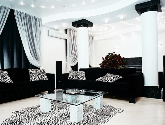 Black Leather Chesterfield Sofa With Turquoise Pillows
