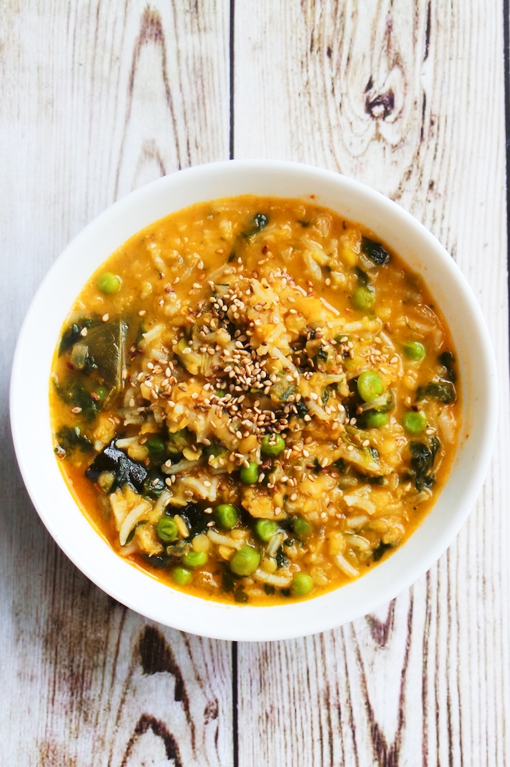 Red curry coconut lentil soup with rice and peas - creamy, easy lentil recipe that you'll want to eat every day! This healthy soup is spicy, tasty and comforting. It's also vegan, paleo and rich in fiber!   clean eating recipes