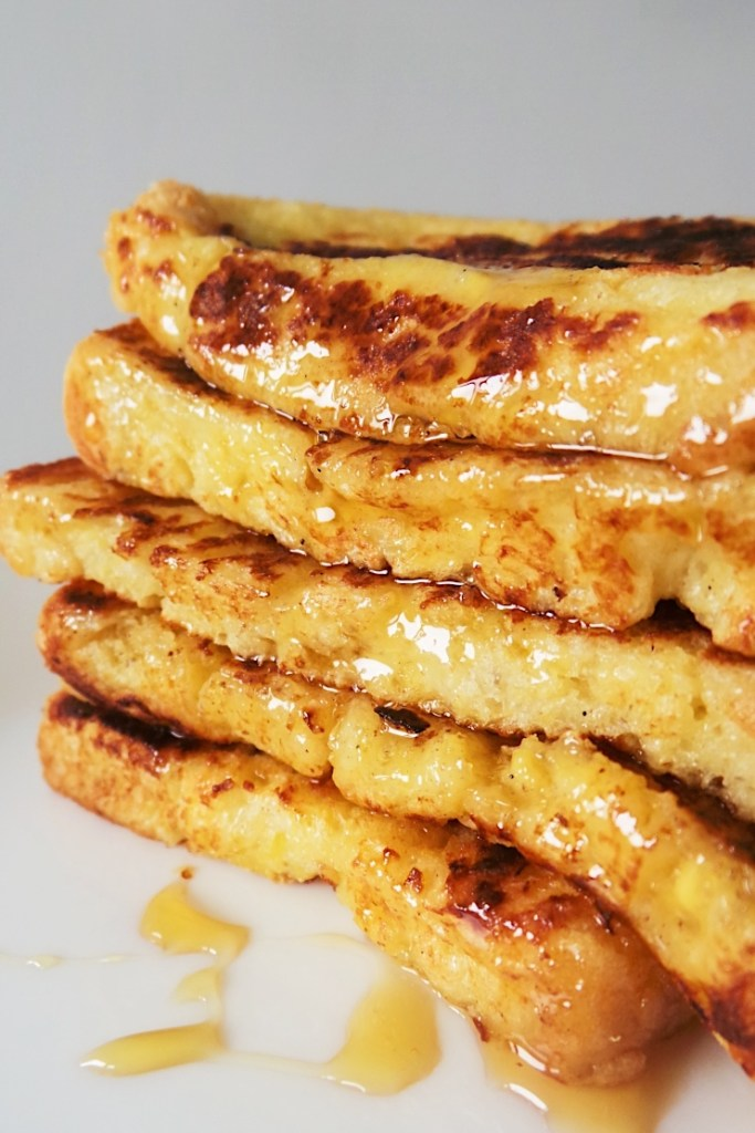 Learn how to make French toast with this super and easy recipe! You don't need any special ingredients to make this tasty and easy breakfast! With cinnamon and honey, this breakfast might even be better than pancakes!