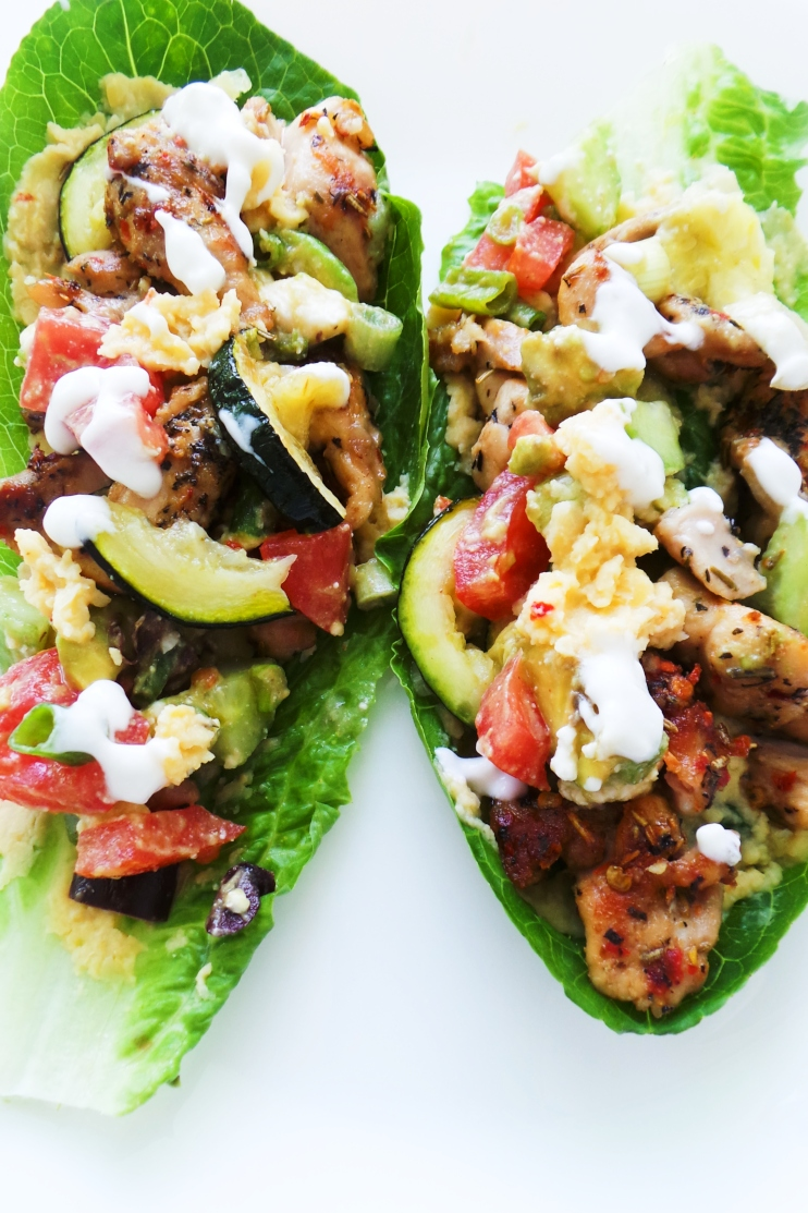 Chicken Lettuce Wraps (Mediterranean Style). These healthy chicken wraps are filled with hummus, salad, chicken, grilled zucchini and a delicious garlic cashew sauce. This tasty chicken recipe is a delicious healthy dinner idea that comes with easy low carb / keto option and meal prep option. Enjoy!