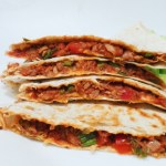 Spicy tuna quesadilla! Easy quesadilla recipe with tuna, tomatoes, cheese and garlic. This is a quick lunch recipe or dinner idea that you can make when you're unprepared, haven't meal prepped and need something delicious.
