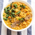 Butternut squash red lentil soup - a creamy, easy and healthy soup recipe! This easy vegan soup is absolutely delicious and perfect for a warming weeknight dinner as it's ready in about 30 minutes.