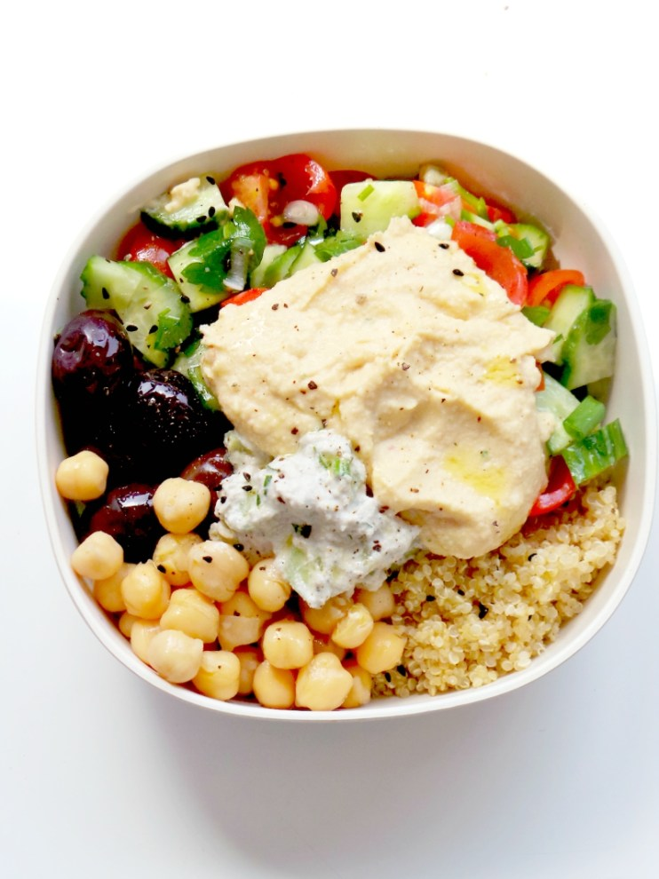 5-Minute Mediterranean Bowl - easy and healthy meal prep lunch or dinner. This vegan Mediterranean bowl is made with hummus, tzatziki, chickpeas, olives, quinoa and a small healthy salad. It's also gluten-free.