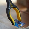 Grabber to pick up the smallest of items such as a credit card from the floor