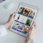 Holding iPad browsing hhadlessentials website handy guides page