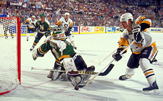 Pittsburgh's Joe Mullen with a scoring chance against Minnesota's Brian Hayward during Game 5 of the 1991 Stanley Cup Final